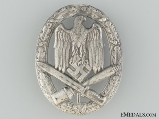 General Assault Badge, in ZincGeneral Assault Badge, in silvered zinc, unmarked, it retains all of the silver finish, in unworn condition.