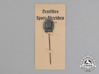 A Silver Grade DRL Sports Badge Miniature Stick Pin on its Original Salesman's Board