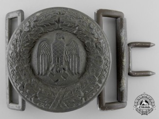 A Tropical Army Officer's Belt Buckle; Published Example