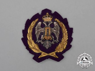 "A Yugoslav Officer's Pioneers/Sappers Visor Insignia; ""British"" Cap Version"