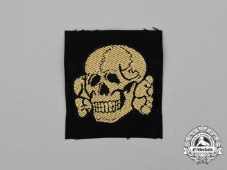 A Mint and Unissued Waffen-SS EM/NCO's Cap Skull; Tropical Cloth Version