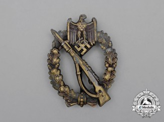 A Second War German Bronze Grade Infantry Assault Badge by Ferdinand Wiedmann