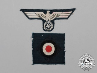 A Set of German Wehrmacht Overseas Cap Insignia