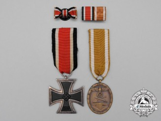 A Second War German Iron Cross 1939 Medal Pair with Boutonniere & Medal Ribbon Bar