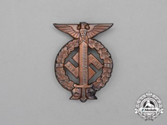 "A 1935 ""Nordmark Forwards"" Celebration Badge"