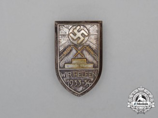 "A 1933/34 WHW ""We are Helping"" Donation Badge"