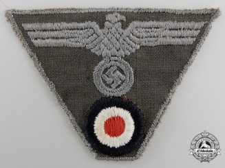 A Wehrmacht NCO M44 Cap Insignia