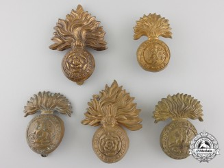 Four First & Second War British Fusilier Cap Badges and One Collar Tab