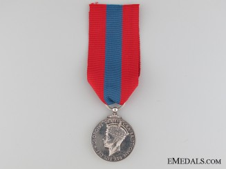 Imperial Service Medal to Carl Eugene Hewett