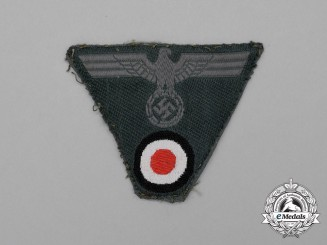 A Third Reich Period German Wehrmacht Heer (Army) Cap Insignia; Uniform Removed