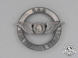 A Civil Aeronautics Administration (CAA) War Training Service Cap Badge