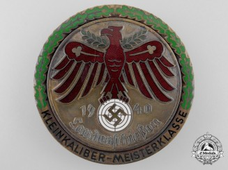 A Gau Champion Badge in Gold with Oakleaves on Volks Target