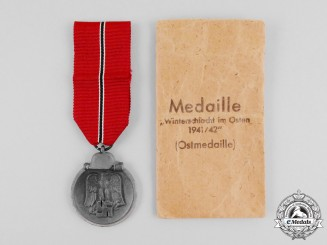 A Second War German Eastern Winter Campaign Medal in its Packet of Issue