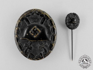 A Second War German Black Grade Wound Badge with First War Stickpin
