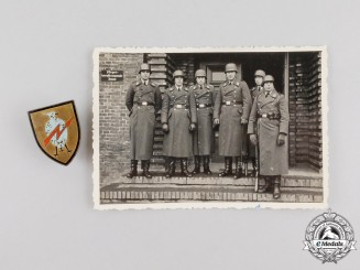 A Rare Luftwaffe Signals Unit Badge with wartime photo of Unit Members & Ordering Letters