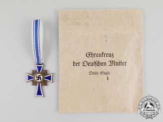A 3rd Class Cross of Honour of the German Mother in its Packet of Issue