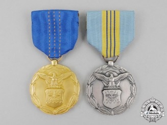 Two American Department of the Air Force Civilian Service Awards