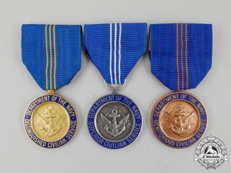 Three American Department of the Navy Civilian Service Awards
