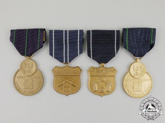 Four American Coast Guard and Navy Shooting Proficiency Medals
