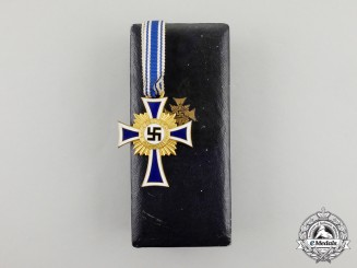 A Cased  Gold Grade Mother's Cross with Instructions for Wear