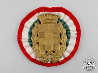 Italy, Kingdom. A Pith Helmet Badge
