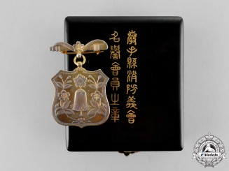 Japan. A Iwate Prefecture Fire Brigade Association Honorary Member Badge, Cased and Boxed