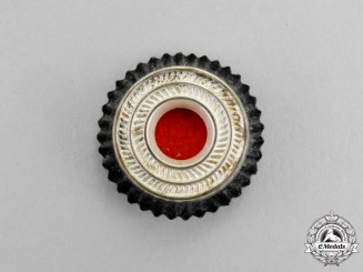 Germany. A Third Reich Period Metal Tri-Colour Cap Cockade