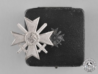 Germany. A Cased Mint War Merit Cross First Class with Swords