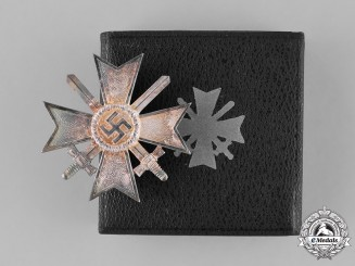 Germany, Wehrmacht. A Cased War Merit Cross, First Class with Swords, by Deschler & Sohn