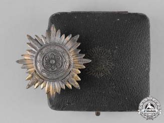 Germany, Third Reich. A Cased Gold Grade Eastern Peoples Bravery Medal, First Class with Swords