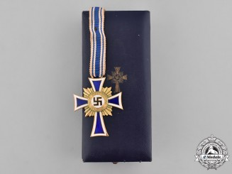 Germany, Third Reich. A Cased Honour Cross of the German Mother, Gold Grade, by Carl Poellath