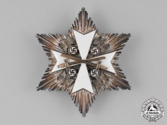 Germany, Third Reich. An Order of the German Eagle, Breast Star with Swords, by Godet & Co., 1943