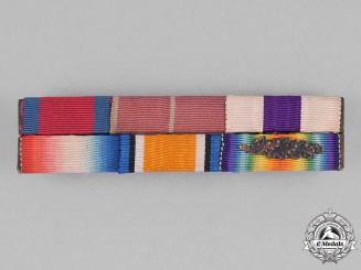 Great Britain. A First War DSO/OBE/MC/MID Ribbon Bar