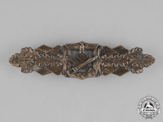 Germany, Wehrmacht. A Close Combat Clasp, Bronze Grade, by C.E. Juncker,