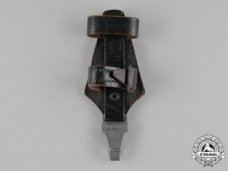 Germany, SS. A Fine Waffen-SS Vertical Dagger Hanger by Wächtler & Lange of Mittweida