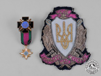 Ukraine. A War Veteran's Lot of Insignia and Miniature Awards