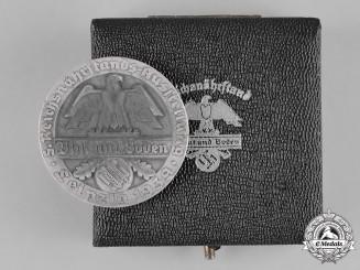 Germany, RNST. A Cased 1939 Reichsnährstand (RNST) Leipzig Speisequarg Medallion