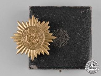 Germany, Wehrmacht. A Cased Eastern People's Bravery Decoration, First Class Gold Grade