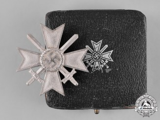 Germany, Wehrmacht. A Cased War Merit Cross, I Class with Swords, by Deschler