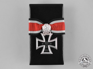 Germany, Wehrmacht. A Cased Knight's Cross of the Iron Cross with Oak Leaves and Swords, 1957 Reissue