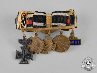 Prussia, State. A Long Service Boutonniere with an Iron Cross 1870 and 25 Year Jubilee Oakleaves
