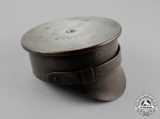 Great Britain. A First War German Artillery Shell Base Trench Art Cap, 1917