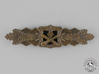 Germany, Wehrmacht. A Bronze Grade Close Combat Clasp by A.G.M.u.K of Gablonz