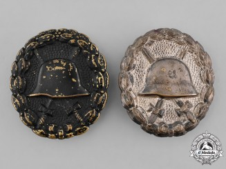 German, Imperial. A Pair of Wound Badges, Silver and Black Grades