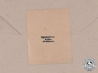 Germany, Wehrmacht. A Packet of Issue for a Spanish Cross in Silver with Swords, by C.E. Juncker