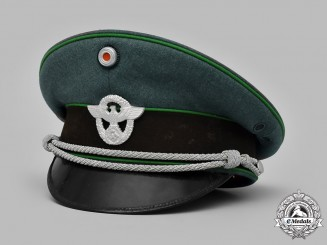 Germany, Ordnungspolizei. A Schutzpolizei Officer's Visor Cap by Peter Küpper, c.1939