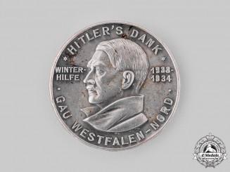 Germany, Third Reich. A 1933-1934 Winterhilfswerk Campaign Donor's Appreciation Badge by Paulmann & Crone