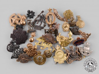 Australia, India, New Zealand, South Africa. Lot of Thirty-Three Cap Badges, Collar Tabs and Shoulder Titles