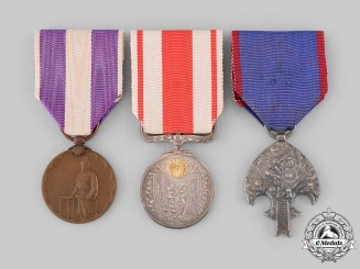 Japan, Empire - Occupied Manchukuo. Three Medals & Awards