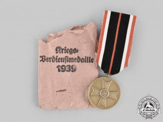 Germany, Wehrmacht. A War Merit Medal, with Package of Issue, by Frank & Reif